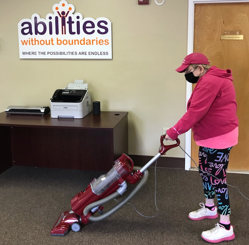 Abilities Without Boundaries AWB individual working at our facility wearing her face mask for COVID-19 times.